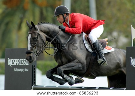 BARCELONA, SPAIN - SEPT, 23: Jesus Garmendia of Spain in action rides horse Perle Condeenne during the 100th CSIO event at the Real Club de Polo Barcelona on September 23, 2011 in Barcelona, Spain