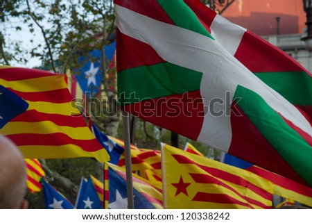 BARCELONA, SPAIN - SEPTEMBER 11: Basque and Catalonian flags during the railly demanding independence for Catalonia, on September 11, 2012, in Barcelona, Spain.