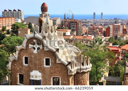 """BARCELONA, SPAIN-SEPTEMBER 28: Famous building at the entrance of Park Guell,designed by Gaudi,on September 28,2010.Part of the UNESCO World Heritage Site """"Works of Antonio Gaudi"""". - stock photo"""