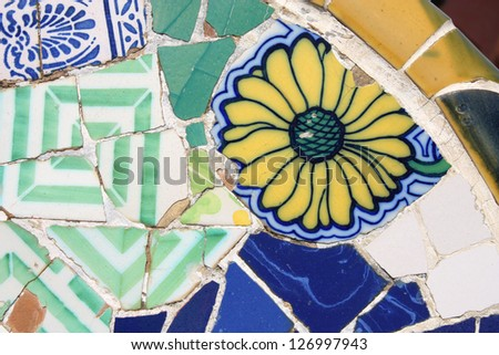 BARCELONA, SPAIN - SEPTEMBER 11: Floral mosaic in Park Guell on September 11, 2009 in Barcelona, Spain. It was designed by famous Antonio Gaudi. Barcelona is the most visited city in Spain.