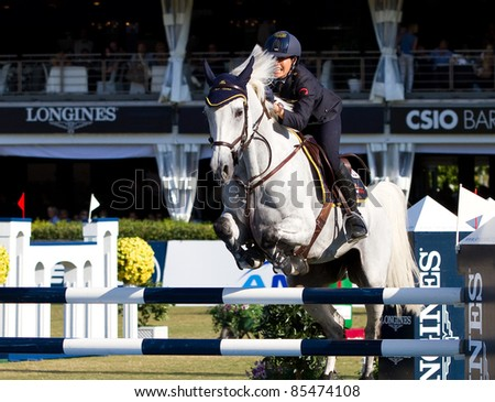BARCELONA, SPAIN - SEPTEMBER 25: Giulia Martinengo from Italy in action during the CSIO 100th International Jumping Competition, on September 25, 2011, in Real Club de Polo, Barcelona, Spain.