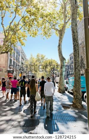 BARCELONA, SPAIN - SEPTEMBER 14: La Rambla on September 14, 2012 in Barcelona, Spain. Thousands of people walk daily by this popular pedestrian area 1.2 kilometer-long