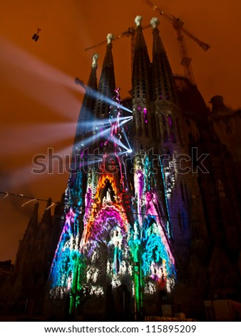 "BARCELONA SPAIN - SEPTEMBER 26: ""La Sagrada Familia"", the cathedral designed by Gaudi, with the spectacle ""ODA A LA VIDA"" during Barcelona Mercè festival, on September 26, 2012 in Barcelona Spain."