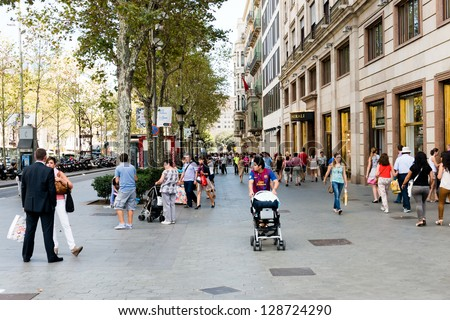 BARCELONA, SPAIN - SEPTEMBER 13:  people walk daily by street in downtown of Barcelona on September 13, 2012.  More than 7 million visitors were in Barcelona in 2012.