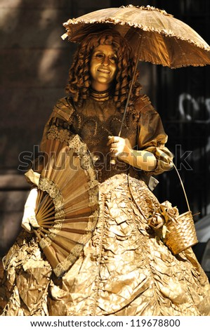 BARCELONA, SPAIN - SEPTEMBER 16 : Street actress in fairy tale style performance in the La Rambla street, Barcelona, Spain on September 16, 2012. - stock photo
