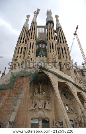 BARCELONA, SPAIN - SEPTEMBER 17, 2013: Works in progress on the facade of La Sagrada Familia - the famous church designed by Antonio Gaudi. It is anticipated that the works will be completed in 2026.