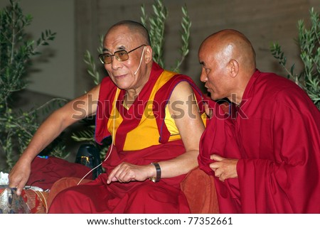 BARCELONA, SPAIN - SEPTEMBER 10: XIV Dalai Lama Tenzin Gyatso (L) speaks in a conference on September 10, 2007 in Barcelona, Catalonia, Spain