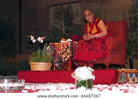 BARCELONA, SPAIN - SEPTEMBER 10: XIV Dalai Lama Tenzin Gyatso speaks in a conference on September 10, 2007 in Barcelona, Catalonia, Spain