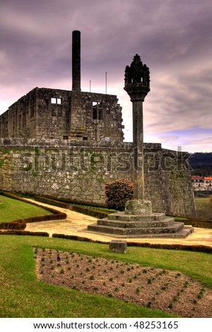 Barcelos city castle in the afternoon under dark cloudy sky (HDR photo)