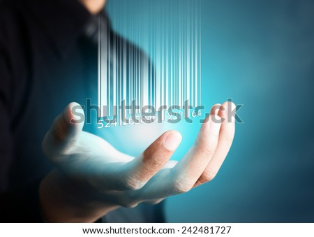 Photo of  Barcode dropping on businessman hand, financial concept