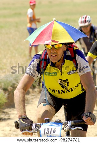 """BARDENAS REALES, NAVARRA, SPAIN- JUNE 28  mountain-bike cyclists during a race through the nature reserve """"The Bardenas"""". on June 28, 2008, in Tudela, Navarra, Spain"""