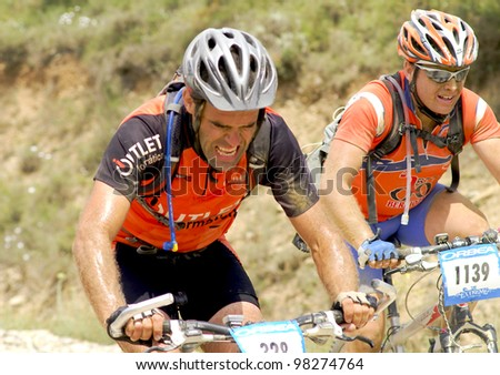 "BARDENAS REALES, NAVARRA, SPAIN- JUNE 28  mountain-bike cyclists during a race through the nature reserve ""The Bardenas"". on June 28, 2008, in Tudela, Navarra, Spain"