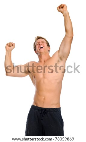 Bare chested athletic man raises his arms up in triumph