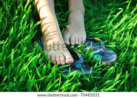 bare feet of girl on a grass