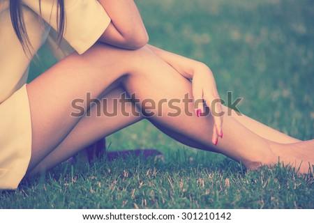 barefoot female legs in grass retro colors #301210142