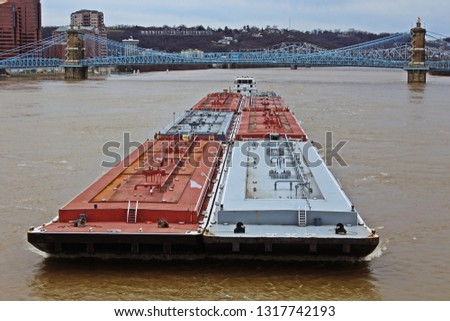 Barge going upstream against high water