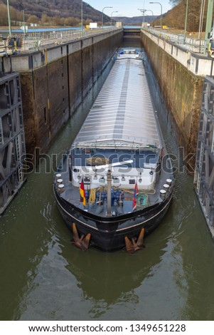 Barge in a lock of the Main Danube Canal near Kelheim, Bavaria, Germany