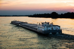 barge in Danube river, at evening sky