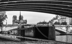 Barge on the river Seine in Paris, in the historical quarter of Notre-Dame de Paris. France. Black and white photo .