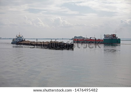 Barge pushed by tug boat on the river #1476495482