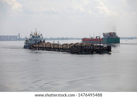 Barge pushed by tug boat on the river. #1476495488
