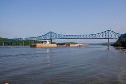 Barge under bridge on Mississippi River at Savanna, IL