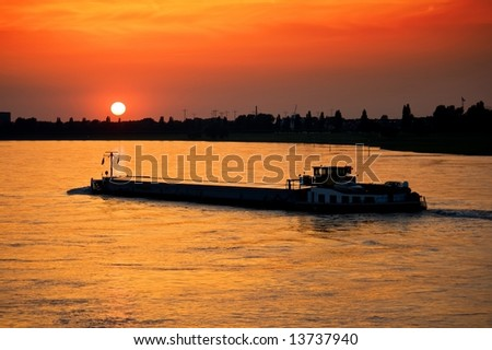 Barge with cargo at sunset