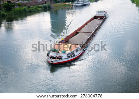 barge with cargo on river
