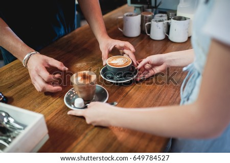 barista and waitress serving coffee #649784527