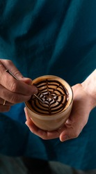 barista is making coffee. Latte art in close-up.