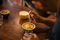 Barista make coffee latte art in training school or coffee shop cafe