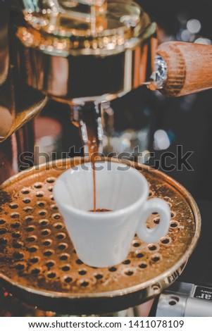 Barista making freshly dripped single espresso in an espresso machine #1411078109