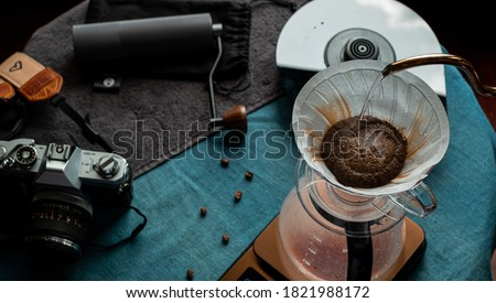 Barista making hand-drip coffee, Hand drip coffee, Barista pouring boiling water to make drip coffee, Tools for making drip coffee