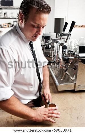 Barista prepares his coffee for the espresso machine - stock photo