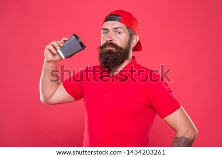 Barista recommend caffeine beverage. Barista job position. Coffee shop staff wanted. Barista prepared drink for you. Cheerful barista. Man bearded hipster red cap uniform hold paper coffee cup.
