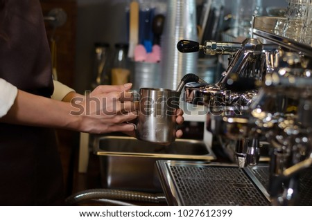 Barista women is a make Cup of coffee latte in coffee shop