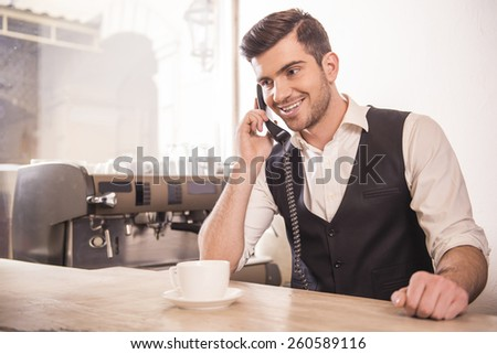 Baristas is taking orders over the phone.