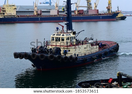 Photo of  Barkas approaches the pier in the port of Odessa.