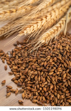 Barley and barley tea on wooden background #1505198096