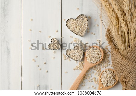 Barley grain in wooden background Barley grain is raw material