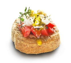 barley rusk called dakos ,topped with feta cheese, tomato cubes,olive oil and oregano ,typical Greek plate served with ouzo or raki