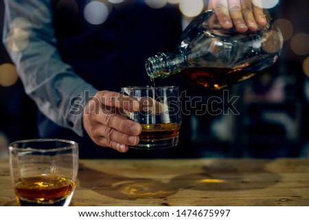 Barman pouring whiskey whiskey glass . #1474675997
