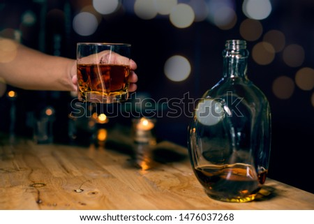Barman pouring whiskey whiskey glass . #1476037268