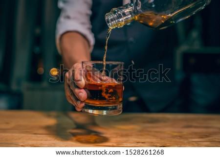 Barman pouring whiskey whiskey glass beautiful night #1528261268