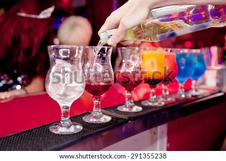 Barman  prepares exotic cocktails at the night club Сток-фото ©