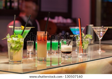 Barman Serving Colorful Cocktails In A Hotel Bar.