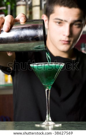 Barman with shaker making cocktail