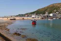 Barmouth is a town and community in the county of Gwynedd, north-western Wales, lying on the estuary of the River Mawddach and Cardigan Bay. Located in the Historic county of Merionethshire.