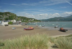 Barmouth town and harbour with landmark railway viaduct over the estuary of the river Mawddach and Cardigan Bay, the marina and quay in Gwynedd, North Wales, UK.