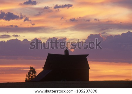 Barn at sunset in silhouette, Davenport, WA